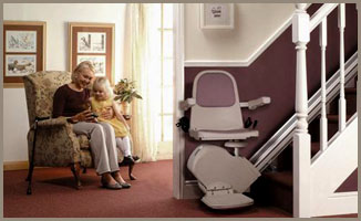Grandmother and grandchild with stairlift
